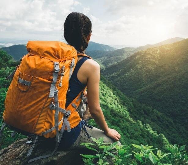 a-girl-with-a-backpack-in-the-mountains