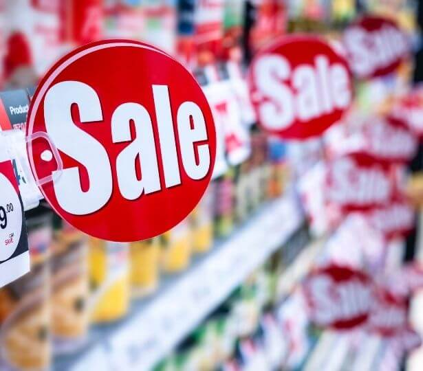 sale-signage-with-a-hook-in-a-store