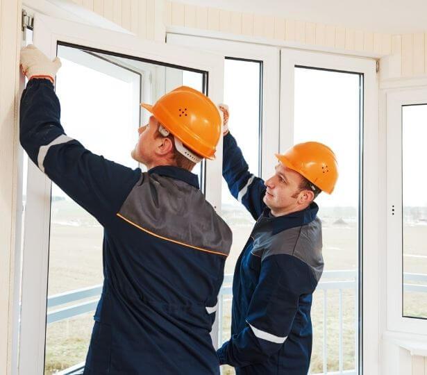 two-men-installing-windows